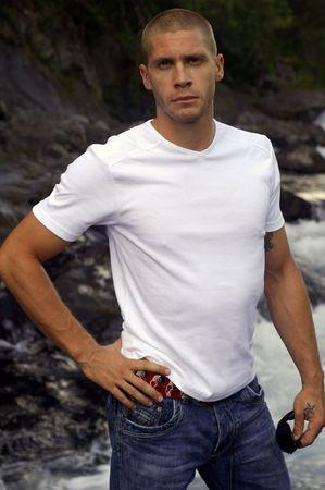young sexy caucasian man, near a river photo