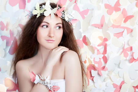 Pretty butterfly girl, romantic image against butterfly background Stock Photo