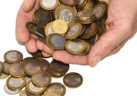 In palms of the person there are a lot of coins of various advantage