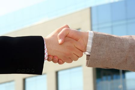 Two businessmen shaking hands after agreement about a job Stock Photo - 863352