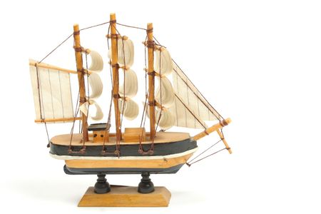 maquette: Wooden ship toy isolated on white background