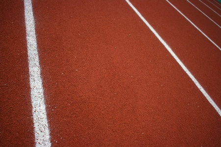 Red tartan sport tracks with white stripes photo