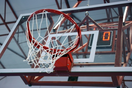 sports hall: Basketball basket without ball or players with number zero on score board, placed indoor