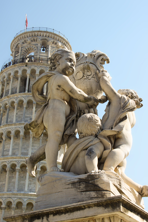 Detail of Fontana dei Putti (fountain with angels) near leaning tower of Pisa, Tuskany, Italy