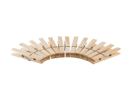 clothespins: Wooden clothespins in semicircle isolated on white background