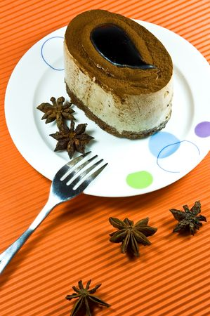 Tasty and colorful brown coffee cake with white cream layer. Stock Photo - 5745865