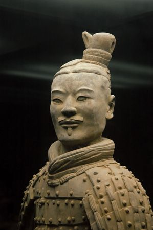 Famous Chinese ancient terracotta warrior portret over dark background.