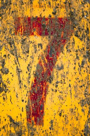 Red grunge number seven painted upon dirty and rusty yellow metal surface. photo