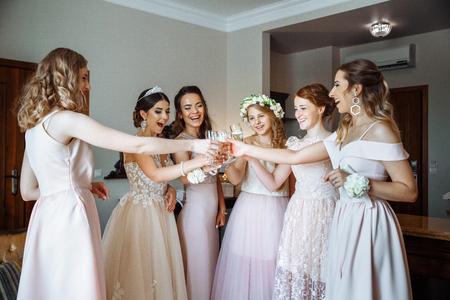 bridesmaids drinking champagne at a wedding