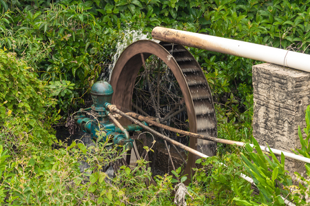 water wheel: Working water wheel generating energy through water.
