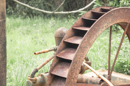 water wheel: Not working old rusty water wheel abandoned to time. Stock Photo