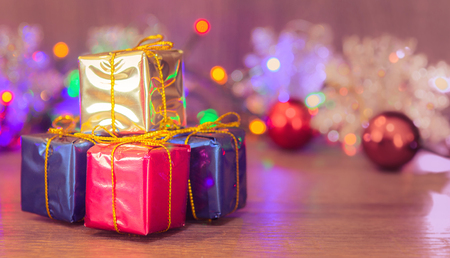december 25: Christmas presents with a beautiful background. Christmas gifts stacked with space next to christmas message.