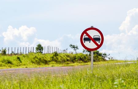 prohibido el paso: Warning: No Trespassing. Warning sign on the roadside for cars.