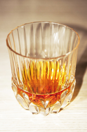 Crystal glass with a dose of pure whiskey, no ice. Stock Photo