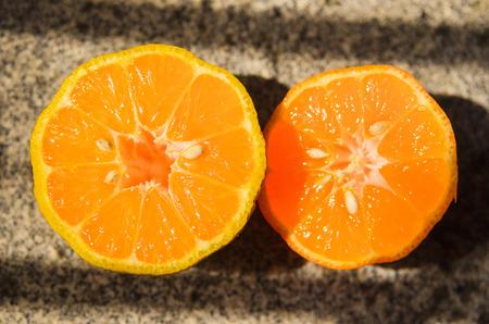 Lemon: Rangpur lime sliced on half with some apparent seeds Stock Photo