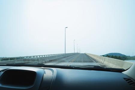 View from inside of a car passing through Ponte Poeta Manoel de Barros bridge. This bridge passes above Paraguai river. Stock Photo