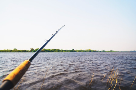 Fishing landscape in the Pantanal of Brazil. Fishing rod thrown in the waters of a river. Fishing activity.