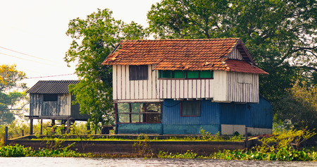 Old wooden house on the margins of a river of Pantanal, Brazil.