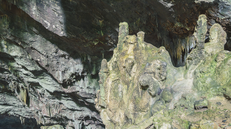 Rock formations and stalactites on the ceiling of the grotto Gruta do Lago Azul in the touristic city of Bonito, Brazil. Stock Photo