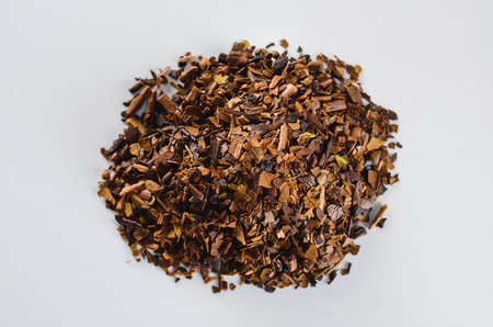 Herbs of toasted Erva-mate. Erva-mate is used to prepare a hot or cold tea drink, the Cha-Mate tea.