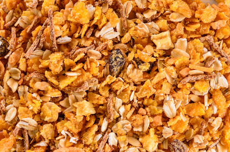 Breakfast: Texture of matinals cereals, flakes and grains, healthy food background. Stock Photo