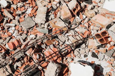 Debris of a demolished wall, demolition junk, broken concrete and pieces of masonry brick. Stock Photo