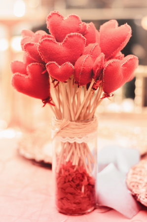 Vase with a bouquet of hearts instead flowers. Love concept, valentines day, mothers day or express love. Warm tones. Stock Photo
