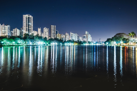 Photo of the Lago Igapo, Londrina - Parana, Brazil. View of the Igapo lake at night and the city, buildings on background. Leisure place, touristic destination of the city. Stock Photo