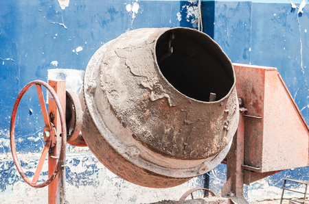 Concrete mixer of a construction. Used, dirty with cement.
