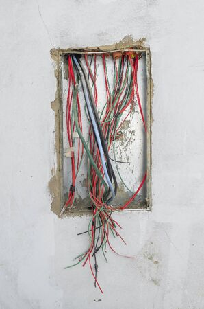 Electric wires of a energy framework of a house under construction. Exposed wires, energy box on the wall. Reklamní fotografie