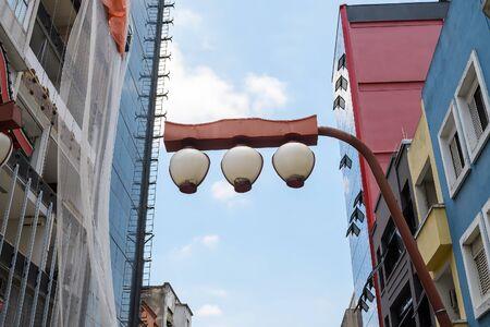 Red japanese themed light pole. Lampposts of Liberdade neighborhood at Sao Paulo, Brazil.