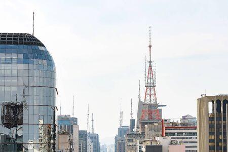 Communication antennas on top of tall buildings. Buildings of Paulista avenue, Sao Paulo SP, Brazil.