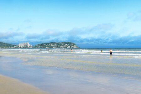 Beautiful day at a touristic brazilian beach. Paulista seacoast, Praia da Enseada beach at Guaruja SP, Brazil.