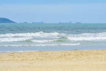 Beach on a beautiful sunny day. Sand and the waves of the sea of Enseada beach - Guaruja SP Brazil. 版權商用圖片