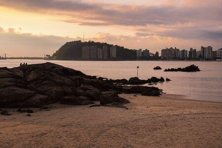 Beautiful sunset at a Brazilian beach of the Paulista coast. Photo taken at Praia dos Milionarios, millionaires beach in english - Sao Vicente SP Brazil.