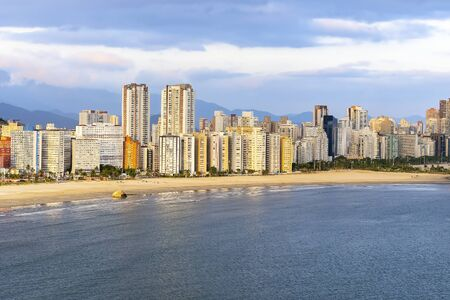 Aerial view of two Brazilian coastal cities of the Paulista coast. End of Praia do Itarare beach at Sao vicente city border with Santos city, Jose Menino beach.