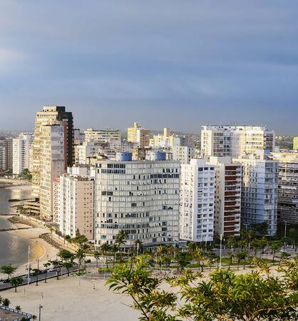 Coastal city with many tall buildings near to the beach. Aerial view of Sao Vicente city, SP Brazil. Paulista coast of Brazil.