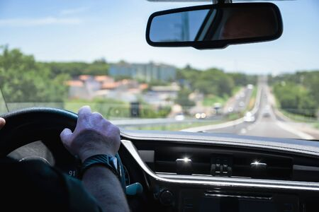 Driving a car on a long highway. View through the inside of a car during a car trip on a Brazilian road. 版權商用圖片