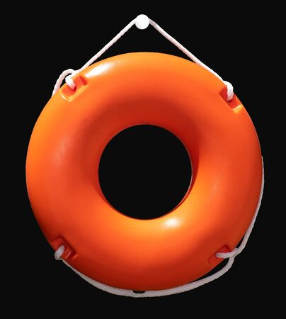 Orange lifebuoy isolated, attached on the wall. Maritime lifeguard equipment.