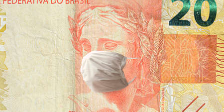 COVID-19, the coronavirus in Brazil. Brazilian effigy of republic symbol at the twenty real banknote with face mask. 20 real brl. Concept of impacts to the economy, crisis and finance.