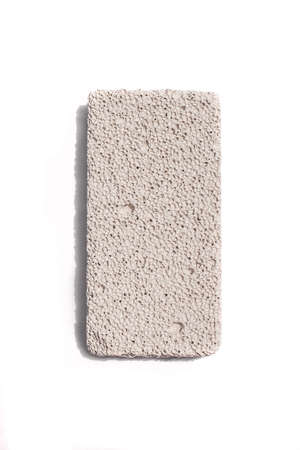 Pumice stone isolated on white background. Volcanic rock used for skin care.