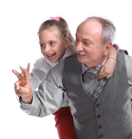Portrait of a little girl enjoying piggyback ride with her grandfather on a white background Stock Photo - 17017410