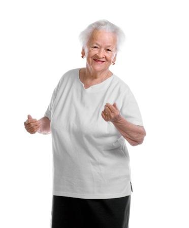 señora mayor: Happly anciana bailando sobre fondo blanco Foto de archivo