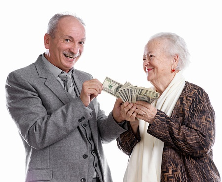 Senior man and old woman with money on white background photo