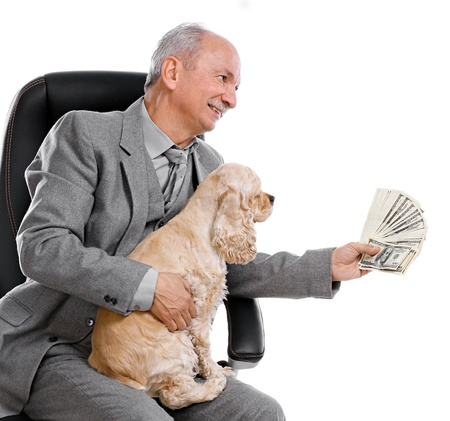 Senior businessman with money and dog sitting on office chair on white background Stock Photo - 17017399