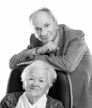 Black and white portrait of senior man with old woman on white background photo