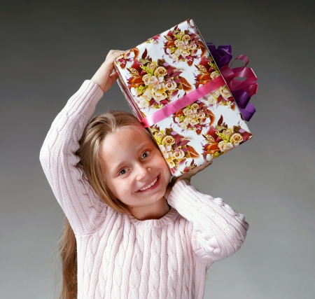 Portrait of happy little girl with gift box Stock Photo - 17017394