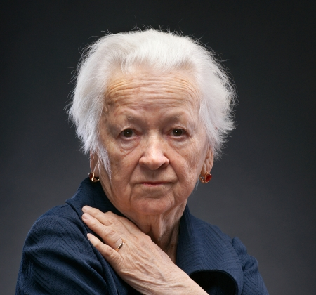 Old woman on a gray background photo