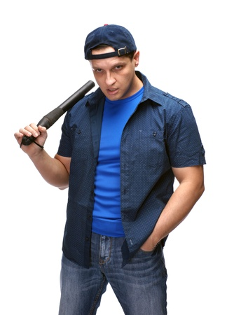 Handsome young man with police stick on white background Stock Photo - 17203925