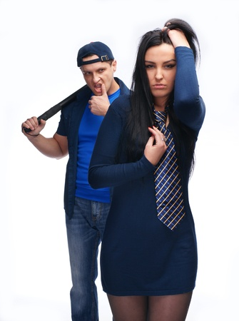 Angry man with police stick and his girlfriend on white background photo